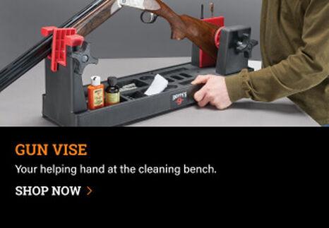 Person using a Hoppe's Gun Vise to clean a shotgun