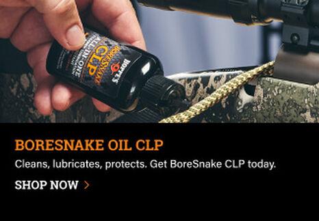 Person applying BoreSnake Oil CLP
