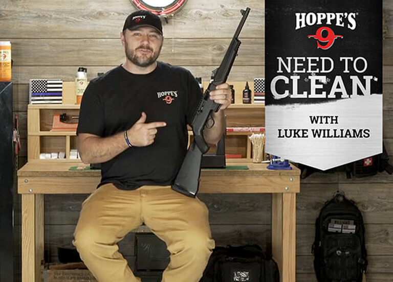 Luke Williams demonstrating how to clean a rifle